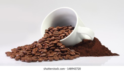 a lot of coffee beans spilled out on a white background