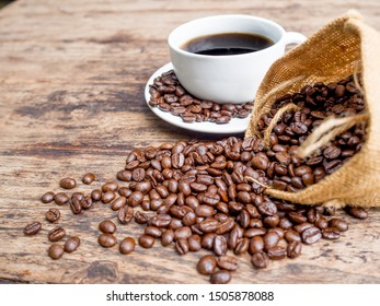 Coffee beans are spilling from the bag, ready to give freshness and alongside the businessman.