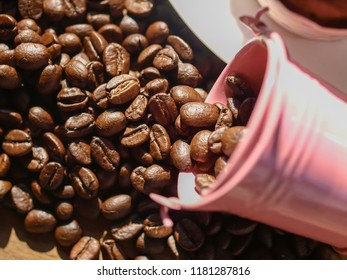 coffee beans spilling from a metal cup