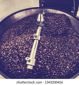 Coffee Beans spinning in Coffee roaster, Coffee Roaster Cooling of Seed, vintage toned, copy space