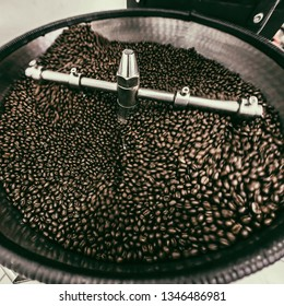 Coffee Beans spinning in Coffee roaster, Coffee Roaster Cooling Batch of Beans, vintage toned, copy space