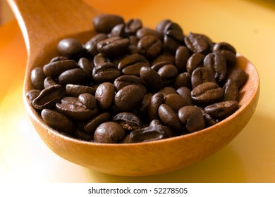 coffee beans in the spoon,close up