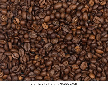 Coffee beans. Studio macro image. A poster or background for design.