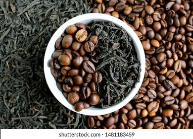 coffee beans and tea in leaves on the same plate