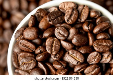 coffee beans in white coffee cup up close fresh roasted caffeine macro coffee break holiday drink beverage pick me up aroma smell good taste good morning drink