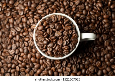 coffee beans in white coffee cup macro close up fresh roasted holiday drink beverage room for text aroma morning drink pick me up caffeine