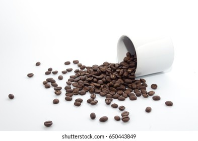 coffee beans and white coffee cup on white background