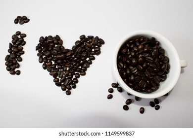 Coffee beans with white glass with white background and Sorting Coffee Beans .concept We love drinking coffee.