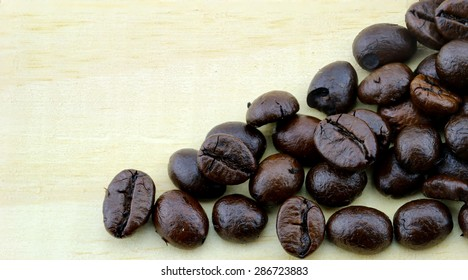coffee beans wih wood background - Shutterstock ID 286723883