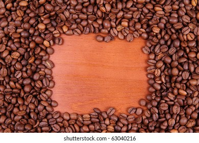 Coffee beans with wooden background in the middle with space for text