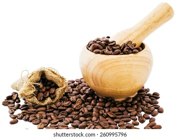 Coffee beans in wooden bamboo mortar isolated on white background. coffee beans isolated in bag
