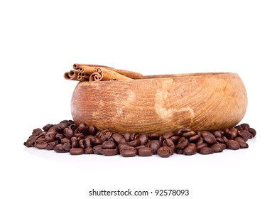 Coffee beans in a wooden cub