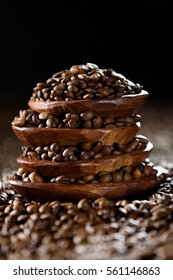 coffee beans in a wooden plates on a dark background
