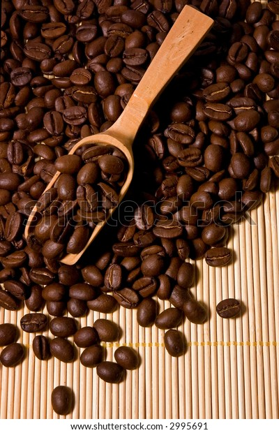 Coffee Beans And Wooden Spoon Background.