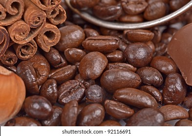 coffee beans,chocolate, spices and nuts ,cup,close-up