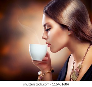 Coffee. Beautiful Girl Drinking Tea or Coffee. Cup of Hot Beverage