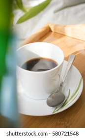 Coffee in bed,early morning cup of coffee.Sunny morning.