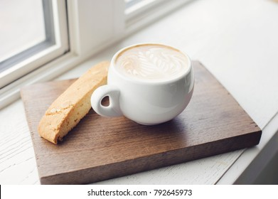 Coffee with Biscotti by Window