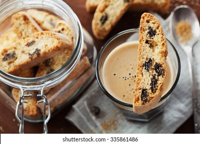 Coffee with biscotti or cantucci on wooden vintage table, traditional Italian biscuit or cookie