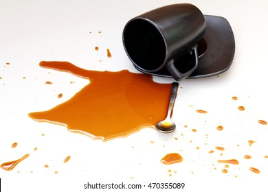 Coffee in black cup spilled on white background isolated