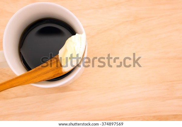 Coffee blended with butter tester good. New trend may forever change the way you drink coffee. Instead of the usual cream and sugar, on wooden background with copy space