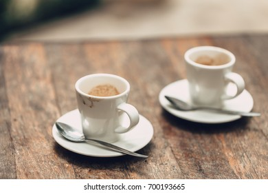 Coffee brake concept two cups of espresso coffee with spoons on wood table