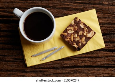 Coffee Break with brownie and marijuana joints set for relax