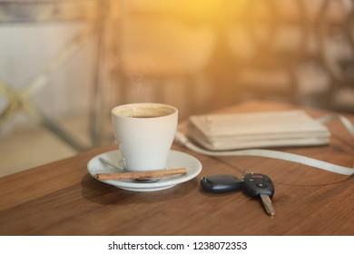 Coffee break at car drive coffee cub kye on wood tabel