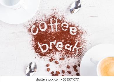 coffee break concept - cups of espresso, spoons and coffee break lettering