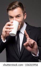 Coffee break. Confident young men drinking coffee and gesturing