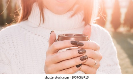 Coffee break. Happy young girl with cup drink tea in morning sunshine. Beautiful woman lifestyle. Smiling happy multiracial female model in her 20s