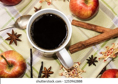 coffee break in the run up to christmas with apples, cinnamon sticks, vanillie, anise,