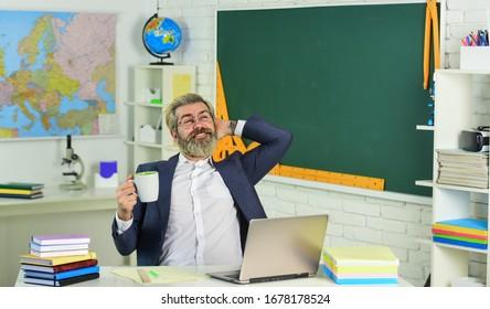 Its coffee break. Senior teacher drink coffee in restroom. Enjoying rest during school break. Break time. Breaktime or recess. School and education.