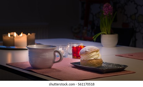 """Coffee break /  This is the famous Swedish """"Semla"""". It is a bun topped with whipped cream. Between the cream and bun there is a layer of almond paste. Preferrable you take it with a cup och coffee."""