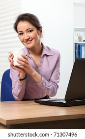 Coffee break for young Asian business woman