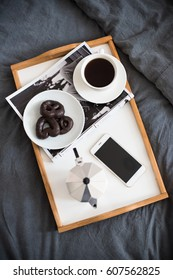 Coffee and breakfast in bed, smartphone and magazine