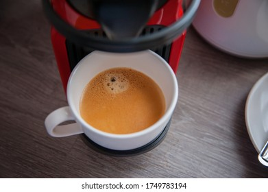 Coffee brewed by a red coffee cup