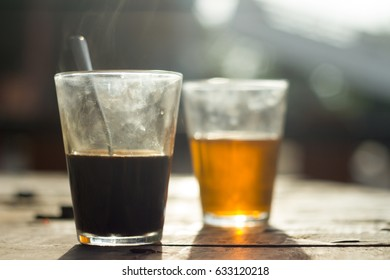 Coffee brewed in traditional vietnamese style with Tea on wooden table