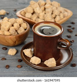 Coffee and brown sugar on a gray background