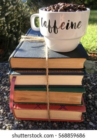 Coffee and a bundle of books