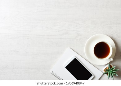 Coffee and business items placed on white background