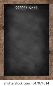 Coffee Cafe chalk handwritten over chalkboard backdrop with brown wooden frame