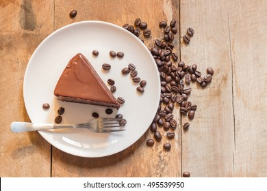Coffee Cake with Coffee Beans on wooden background