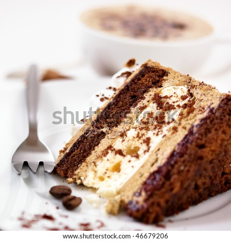 Coffee Cake. Piece of Cake on a Plate. Sweet food. Sweet dessert. Wooden bakcground. Close up.