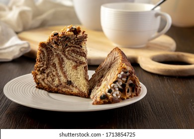 coffee cake with zebra pattern with white teapot and cup.