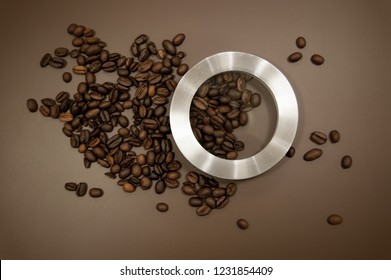 coffee canister lid and coffee beans scattered on the table
