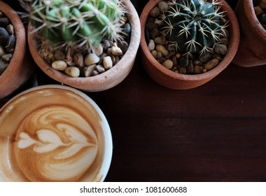 Coffee and Cantus on wooden table