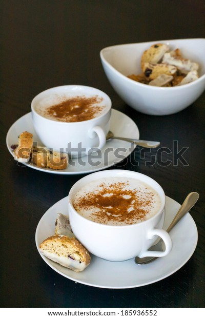 Coffee cappuccino with biscotti