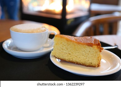 Coffee (cappuccino) and lemon cake in a coffee shop.