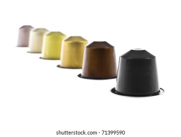 coffee capsules line with different colors isolated on white